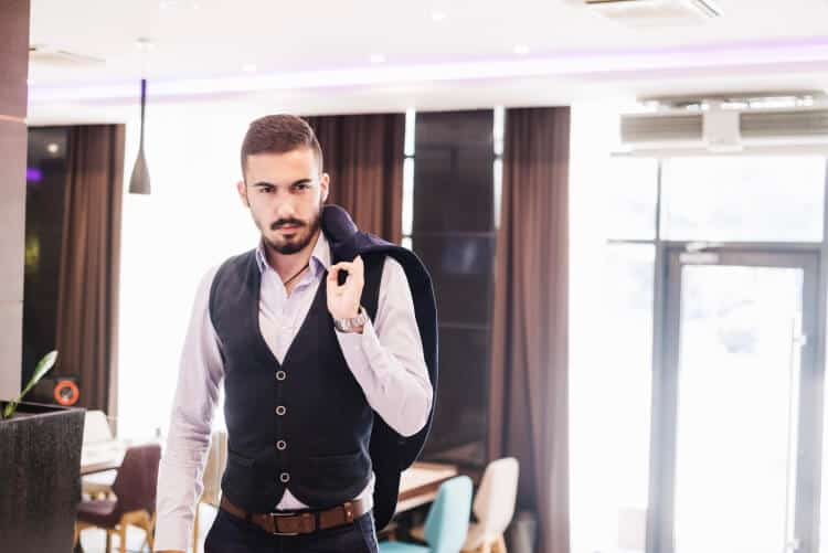 how to wear a vest for a man