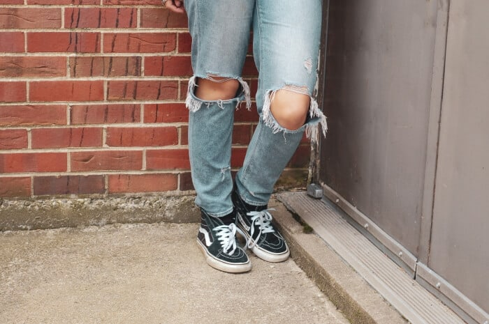 rip jeans at the knee